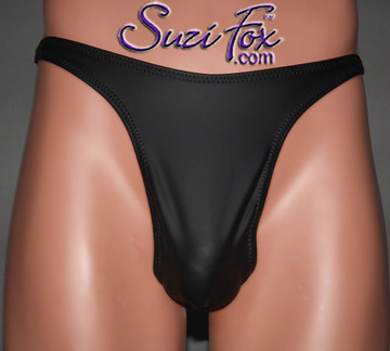 Mens Smooth Front, Wide Strap, T-Back thong - shown in Black Matte (no shine) Vinyl/PVC Spandex, custom made by Suzi Fox. • Available in matte black (no shine), matte white (no shine), gloss black, white, red, navy blue, royal blue, turquoise, purple, Neon Pink, fuchsia, light pink, black 3D Prism, red 3D Prism, Turquoise 3D Prism, Baby Blue 3D Prism, Hot Pink 3D Prism Vinyl/PVC or any fabric on this site. • Standard front height is 10 inches (25.4 cm). • Available in 4, 5, 6, 7, 8, 9, and 10 inch front heights. • Wear it as swimwear OR underwear! • Made in the U.S.A.