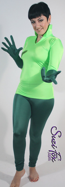 Womens Leggings shown in Hunter Green Milliskin Tricot Spandex, custom made by Suzi Fox. You can order this in almost any fabric on this site.  • Custom made to your measurements! • Available in black, white, red, royal blue, sky blue, turquoise, purple, green, neon green, hunter green, neon pink, neon orange, athletic gold, lemon yellow, steel gray Miilliskin Tricot spandex. This is a 4-way extreme stretch fabric with a slight shine. Light, airy, thin, and very comfortable! • 1 inch elastic at the waist. • Optional 1 or 2-slider crotch zipper. • Optional ankle zippers • Optional rear patch pockets • Optional belt loops • Made in the U.S.A.