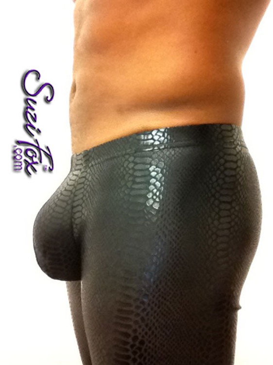 Pouch Front pants shown in Black Metallic Snake Print Spandex, custom made by Suzi Fox. Custom made to your measurements! Choose your pouch size. Low Rise shown. • Available in any fabric on this site. • 1 inch no-roll elastic at the waist. • Optional belt loops. • Optional rear patch pockets. • Your choice of ankle style - tight ankles, jean cut, boot cut, or bellbottom. Made in the U.S.A.