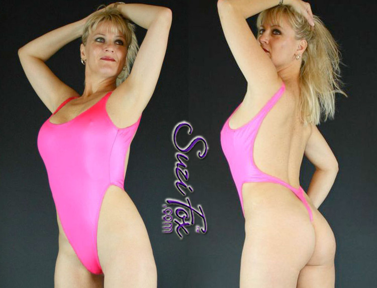 Womens One Piece T-back Thong Swim Suit shown in Hot Pink Wet Look lycra Spandex, custom made by Suzi Fox. • Custom made to your measurements. • The high leg hole, low back and t-back thong rear create a stunning and sexy suit. • Available in black, white, red, turquoise, navy blue, royal blue, hot pink, lime green, green, yellow, steel gray, neon orange Wet Look, and any fabric on this site. • Made in the U.S.A.