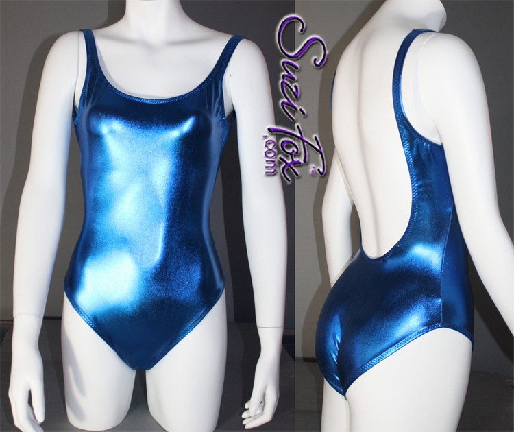 Womens One Piece Swim Suit with full coverage rear shown in Royal Blue Metallic foil Spandex, custom made by Suzi Fox. • Custom made to your measurements. • The high leg hole, low back and full coverage rear create a stunning and sexy suit. • Available in gold, silver, copper, gunmetal, turquoise, Royal blue, red, green, purple, fuchsia, black faux leather/rubber Metallic Foil, and any fabric on this site. • Made in the U.S.A.