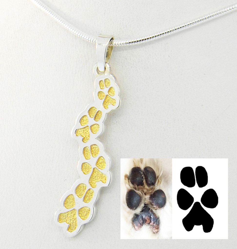 Sterling Silver Journey Pendant made from custom paw print with 18K gold inlay.