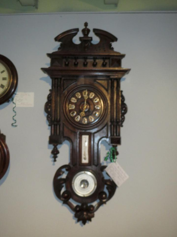 Victorian solid walnut wall clock with barometer and temperature gauge.