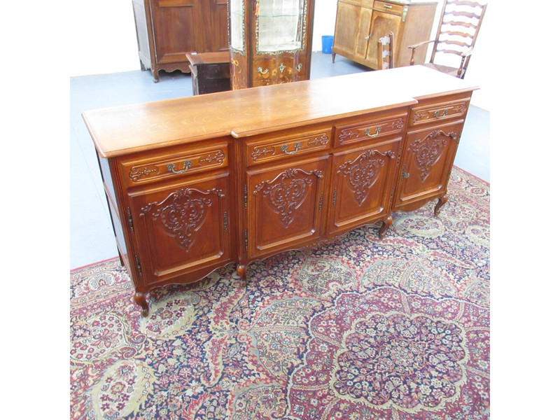A French oak 4 door unrestored carved sideboard