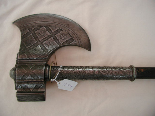 18the century battle axe with hand engraved steel art work. #555