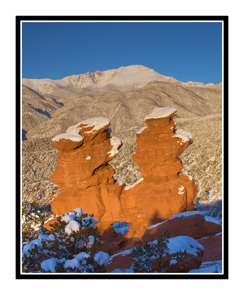 Pikes Peak over Siamese Twins Covered in Snow in Garden of the Gods in Colorado Springs, Colorado 2416