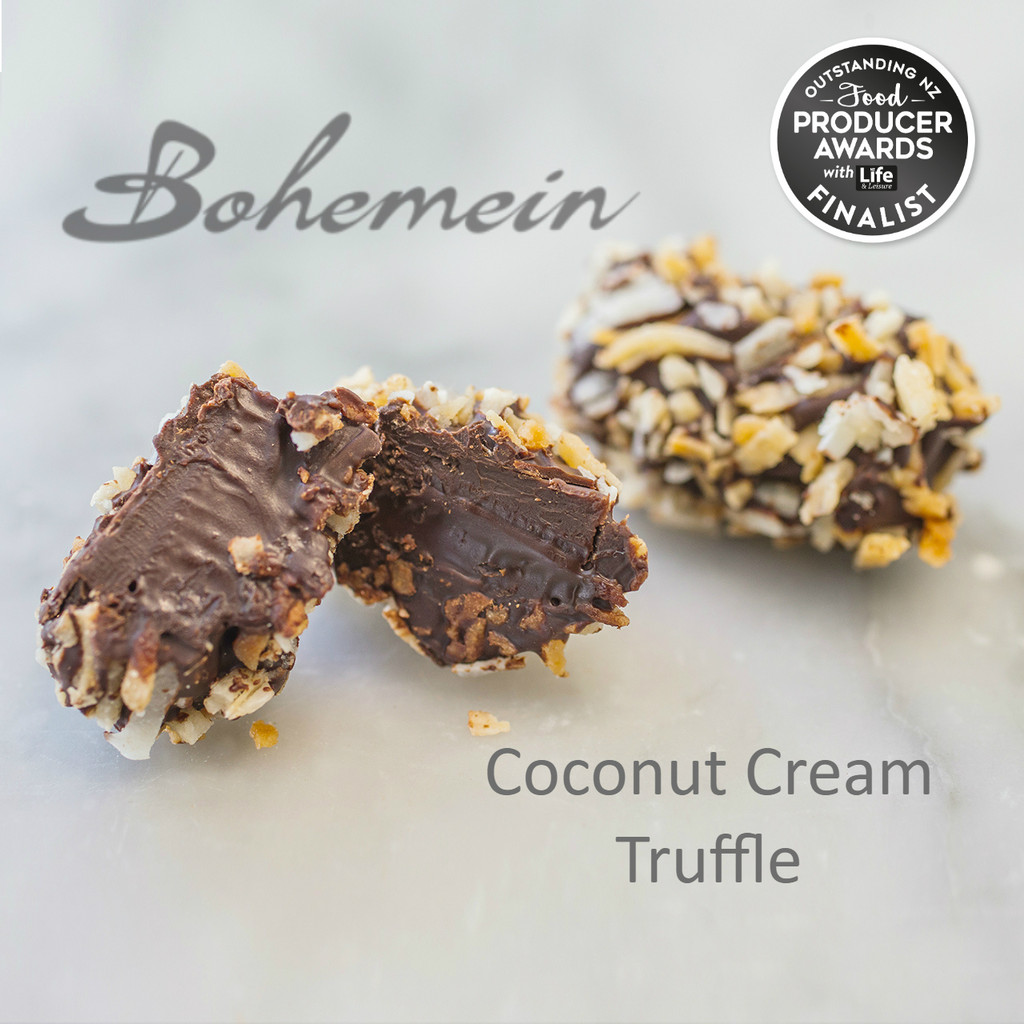 Bohemein Coconut Cream Truffle. A smooth, sweet dark chocolate and coconut cream Ganache, dipped in bitter dark chocolate and rolled in sweet and crunchy candied coconut. Dairy FREE