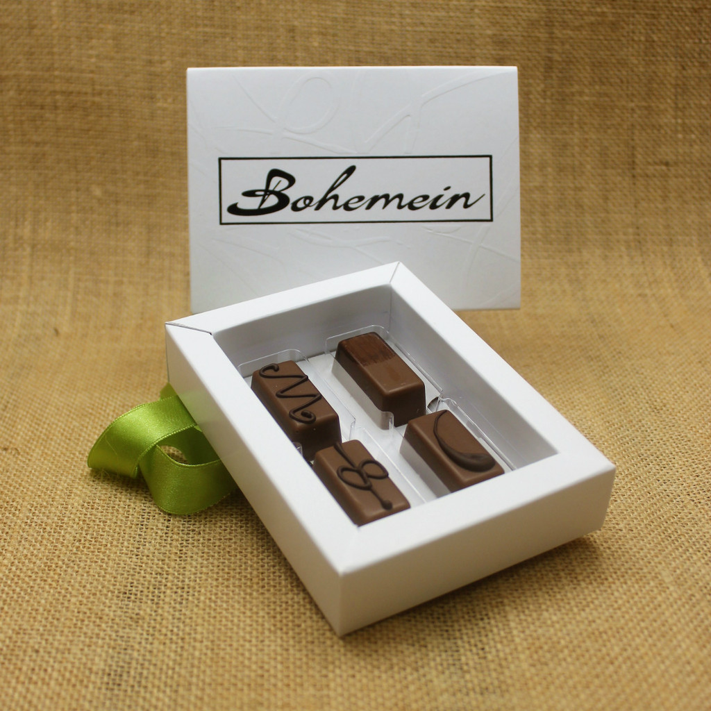 Bohemein 4 Milk Chocolates Gift Box includes: Maple Cream, Vanilla Cream Milk, Chocolate Caramel, Cointreau Ganache.
