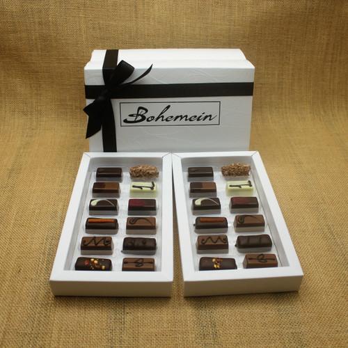 Bohemein Gift Box with 24 Nut Free Chocolates including: Chilli Ganache x2, Maple Cream x2, Rosemary and Apricot Ganache x2, Pineapple and Black Pepper Ganache x2, Chocolate Caramel x2, Melting Passion Ganache x2, Vanilla Cream - Milk x2, Balsamic Vinegar and Honey Ganache x2, Cointreau Ganache x2, Raspberry Ganache x2, Lemon and Thyme Ganache x2, Coffee Truffle x2