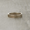 Monhegan nature-inspired twig wedding ring with a single white diamond.