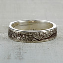 Sterling silver Syracuse wedding ring with light oxidation.