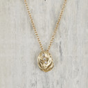 Gold and diamond shell necklace