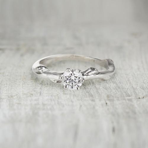 Unique diamond solitaire engagement ring
