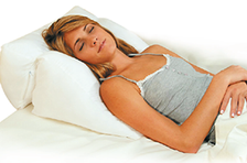 Use as a bed wedge behind back while sleeping