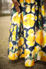 All for Love Ivory and Yellow Floral Gown with Pockets detail view.
