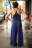 Ride the Waves Navy Draped Jumpsuit with Pockets back view.