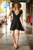 Flirty and Flawless Black Fit and Flare Wrap Dress full body front view.