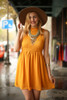 Bold in Mustard High Neck Babydoll Dress front view.