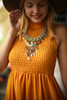 Bold in Mustard High Neck Babydoll Dress detail view.