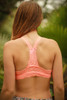 Delicately Stunning Y-Back Lace Bralette in Neon Peach back view.