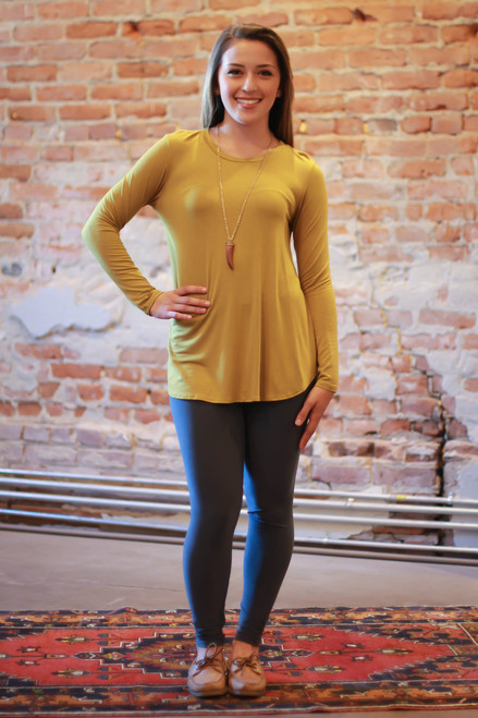 Dark mustard long sleeve top full body front view.