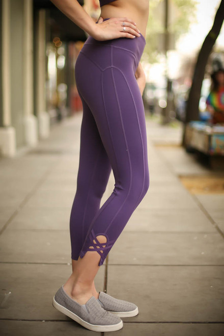 Activated Athletics Dark Violet Leggings with Side Crossed Detail side view.