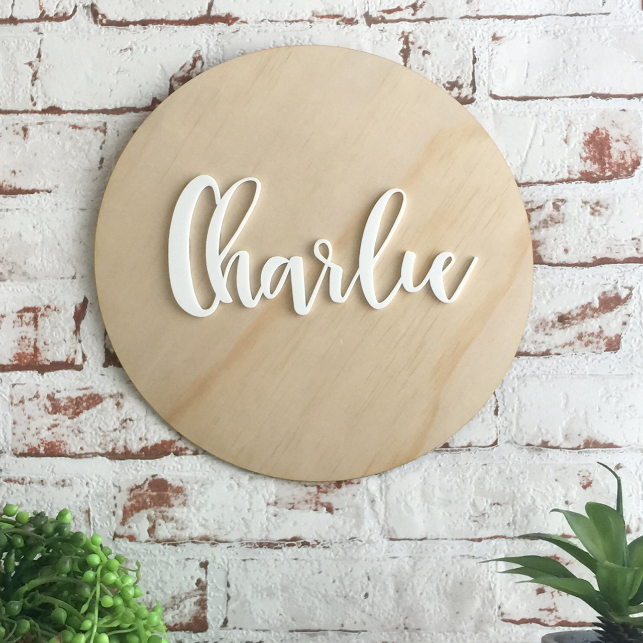 A Personalised wooden hanging with coloured name