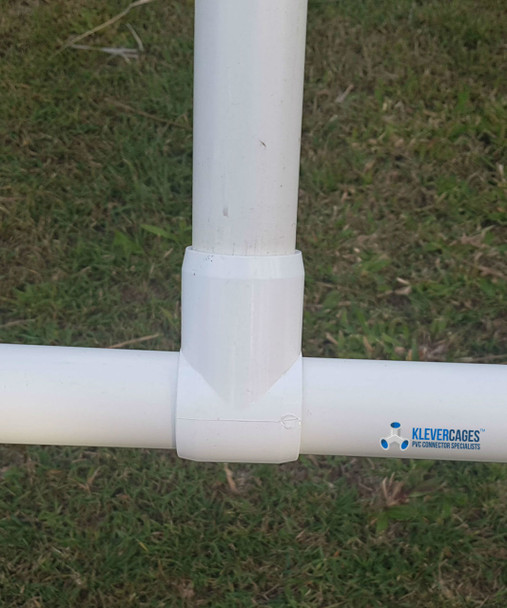 PVC slip tee in use connected to PVC plumbing pressure pipe