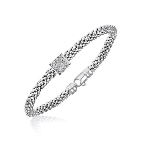 Sterling Silver Rhodium Plated Diamond Embellished Popcorn Bangle (.13ct tw)