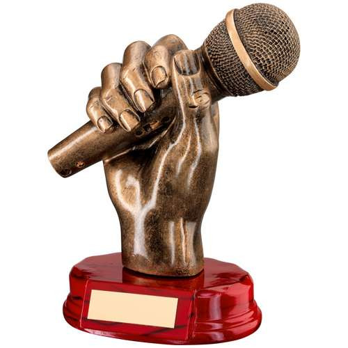 Music trophy, microphone in hand