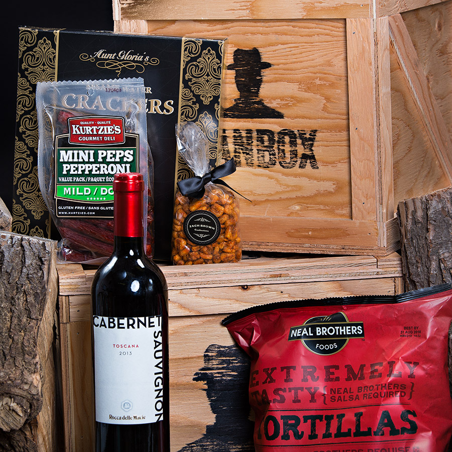 A Red Wine Snack Attack for him!  Gift Includes: •Keepsake Canadian Made Manbox Gift Experience •Cabernet Sauvignon •Sesame Water Crackers  •Sonoma Jacks Pepper Jack Cheese •Roasted Corn Nuts •Kurtzies - Mini Peps Pepperoni Mild  •Multigrain Tortilla Chips •Neal Brother's Organic Medium Salsa