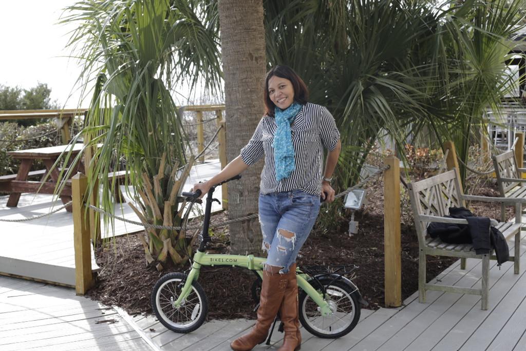 mini folding bike at the beach