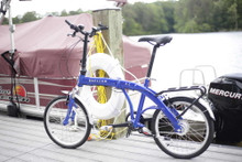 8C folding bike standing with a boat