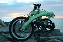 mini folding bike on the water