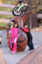 mini folding bike with kids on top of a jug