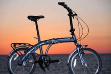 8H folding bike at the beach