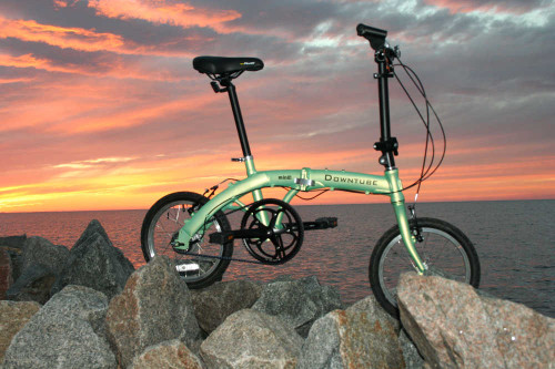 mini folding bike standing  waterfront