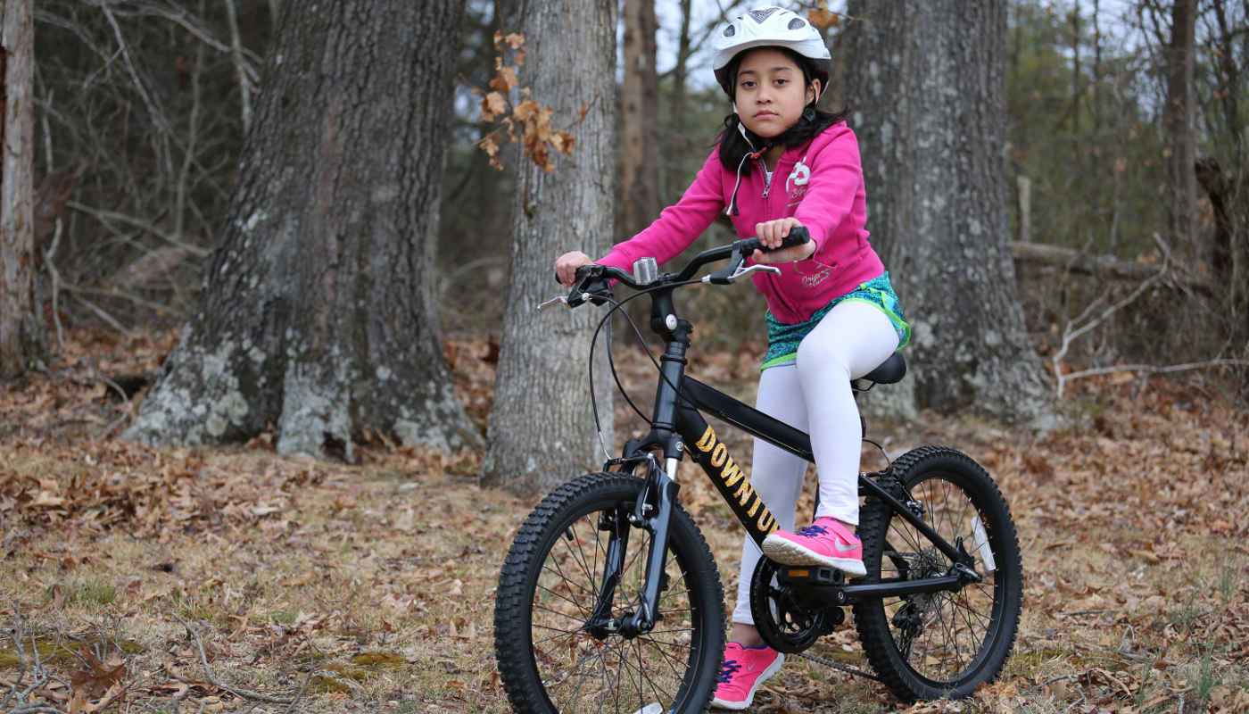 Race kids mountain bike with girl