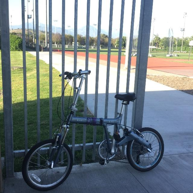 8FS silver folding bike on campus