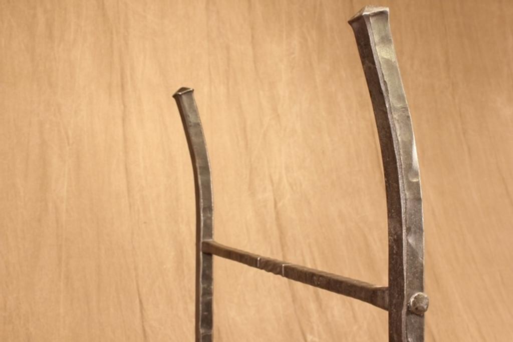 wrought iron four post log rack - detail