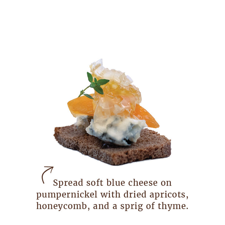 Spread soft blue cheese on pumpernickel with dried apricots, honeycomb, and a sprig or thyme.