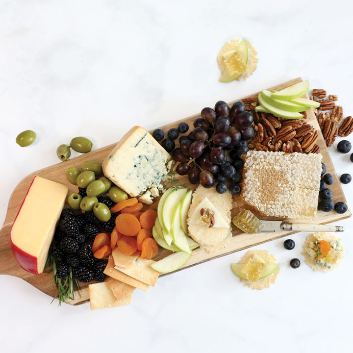 Pile your honeycomb platter with a variety of cheeses, fruits, olives, nuts, and meats and serve with crackers and bread bites.