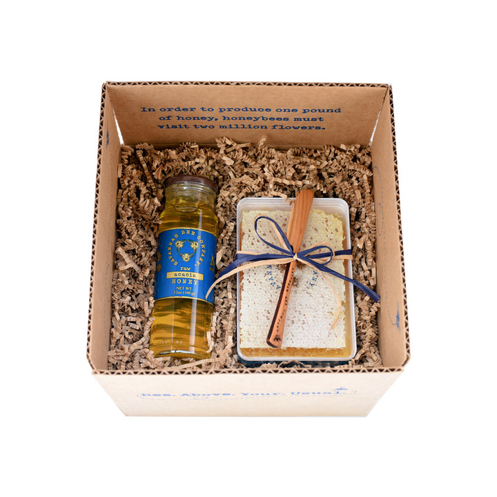 The Good Tidings Gift Set includes one 12oz Acacia Honey, one 12.3oz Raw Acacia Honeycomb and one cherry wood honeycomb knife.