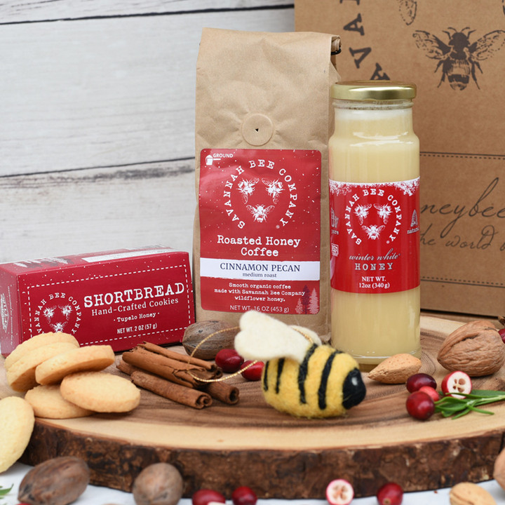 The Winter Wonderland Holiday Gift includes one 2oz box of Tupelo Honey Shortbread Cookies, one Felted Bee Ornament, one 16oz Honey Cinnamon Pecan Ground Coffee, and on 12oz Winter White Honey.