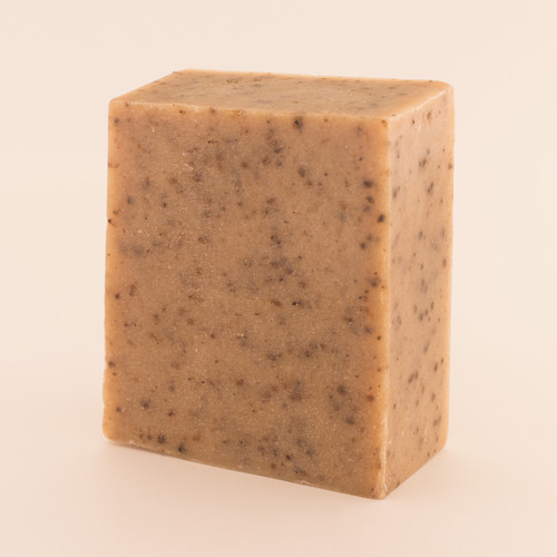 Unwrapped bar of discounted Coffee Scrub goat milk soap.