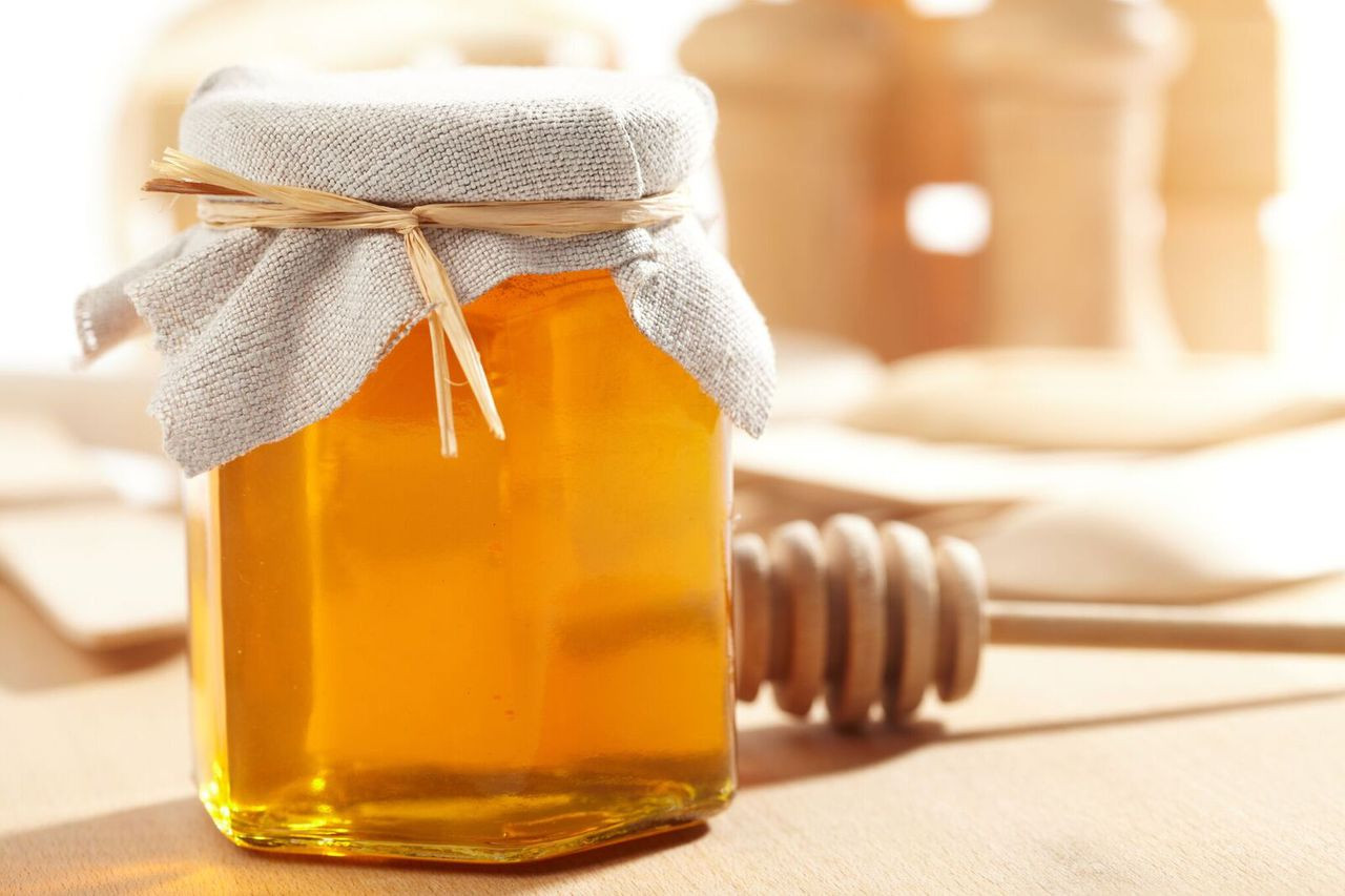 Honey Favor with hexagon jar for sale and wooden honey dipper.