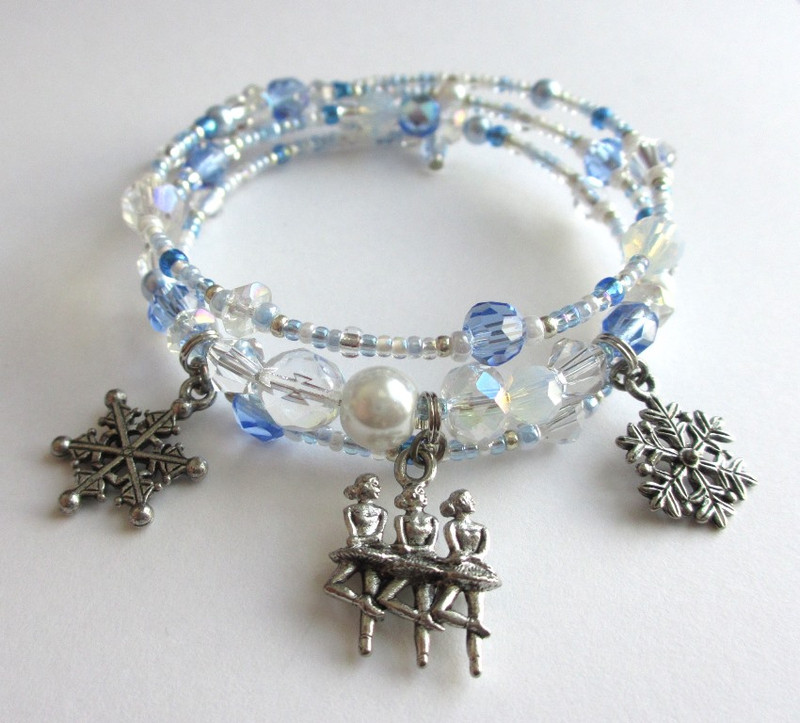 Beads of blue, white and crystal evoke the swirling dancing snowflakes.