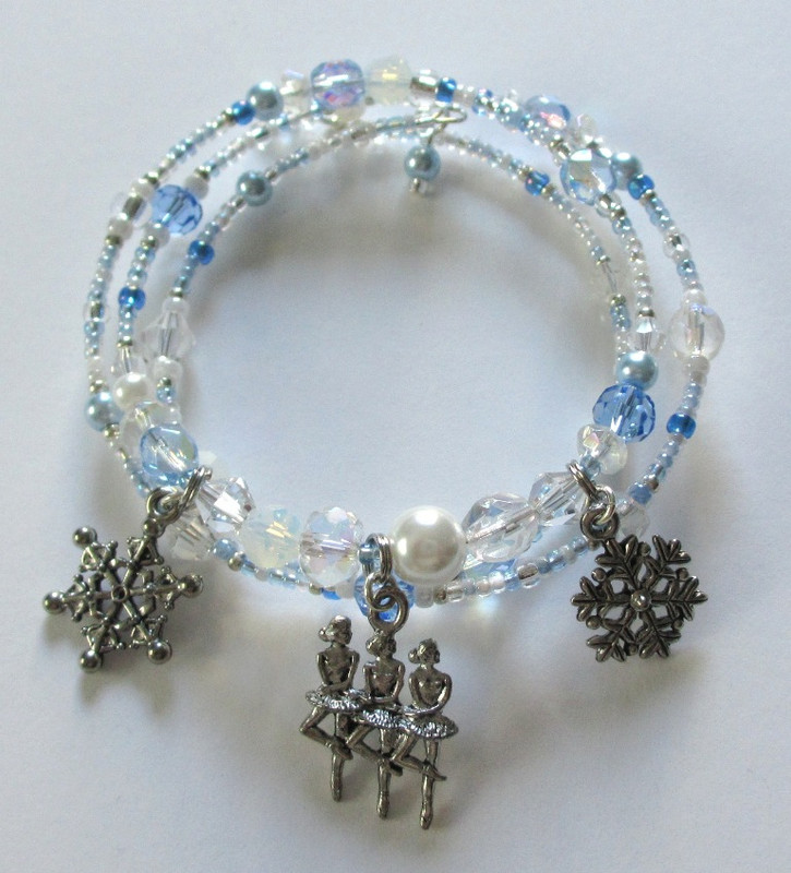 Sparkling beads symbolize the swirling snow flakes.