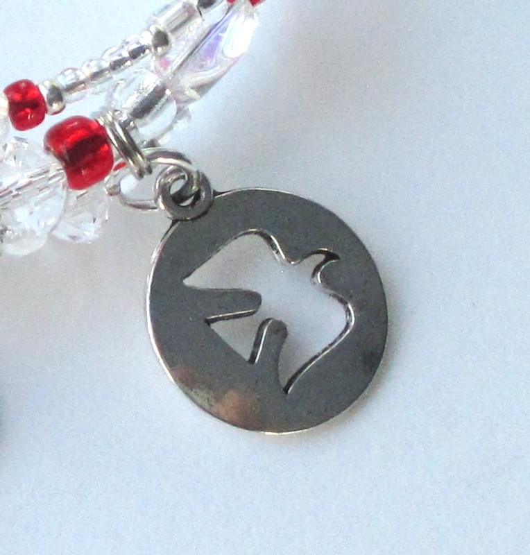 The dove charm represents the Grail Knights.