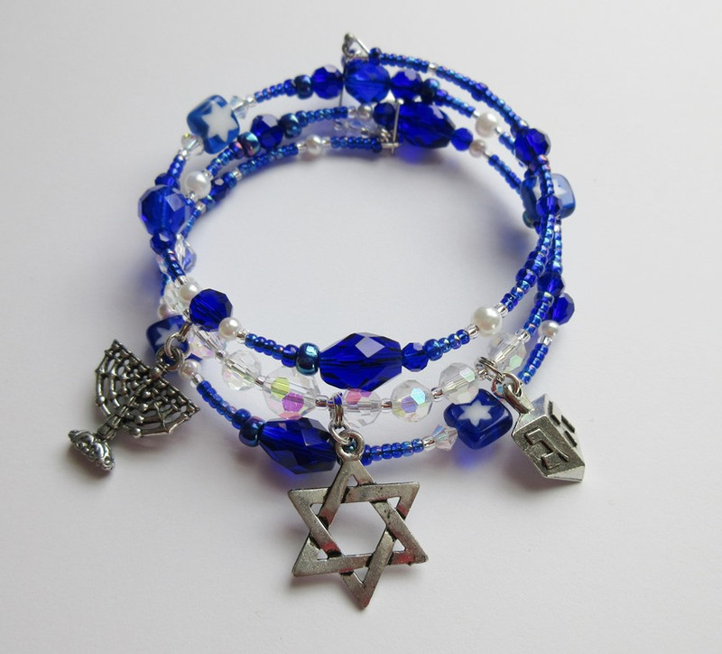 A special bracelet celebrating the traditions of Hanukkah! Deep blue beads evoke the eight nights of the festival.  Crystals symbolize the flames of the menorah.